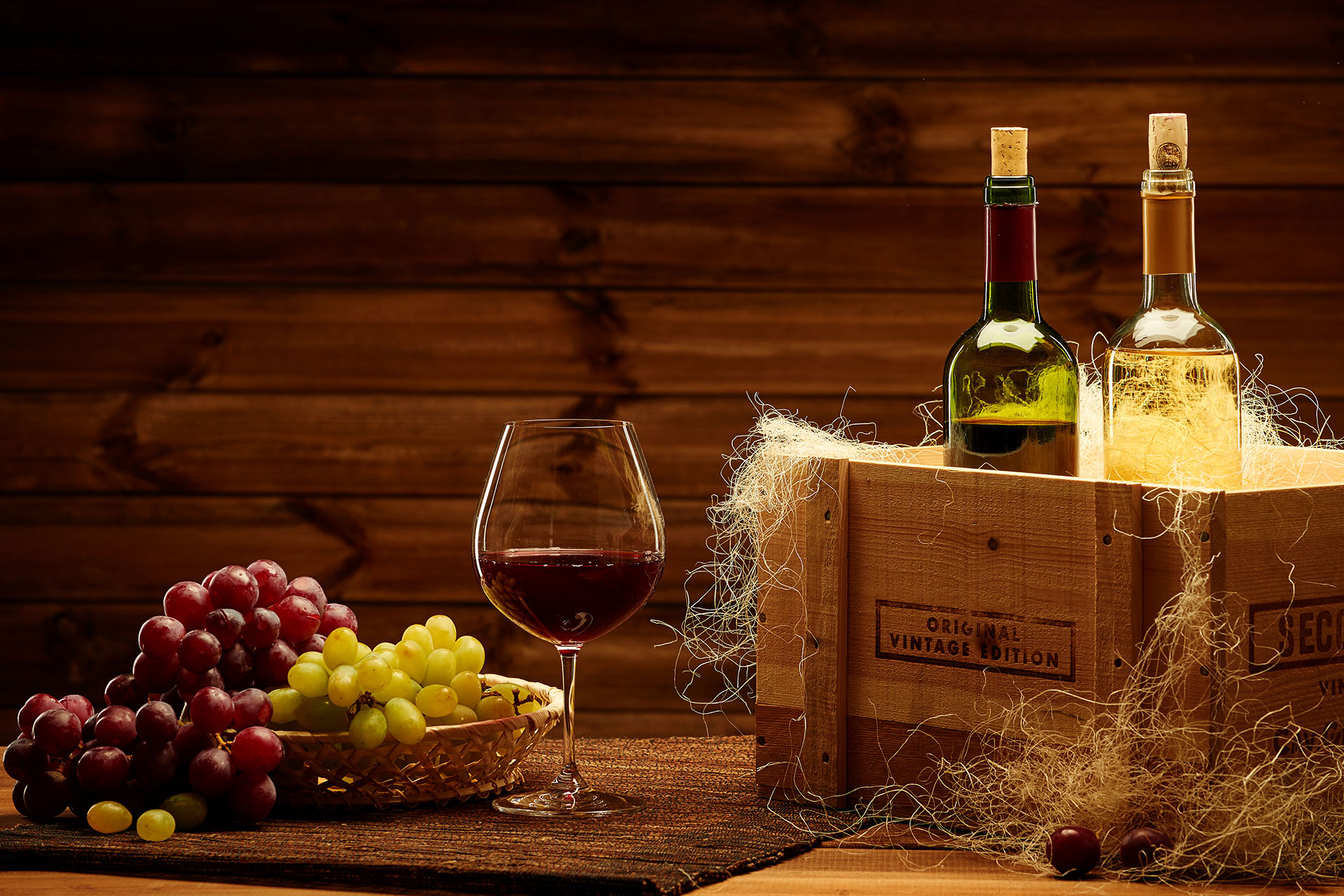 Bottles of red and white wine on a wooden interior